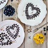 Chocolate Lace Pancakes with Mango, Blueberries and Yoghurt