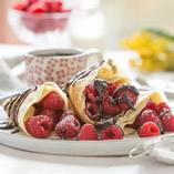 Crepes with Raspberry and Chocolate Fudge Sauce