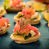 Mini Breakfast Blinis with Smoked Salmon, seasonal baby leaves, crème fraiche with horseradish & dill with red onion pickle