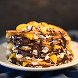 Pancake Stack with Orange Segments, Chocolate Fudge Sauce and Toasted Hazelnuts